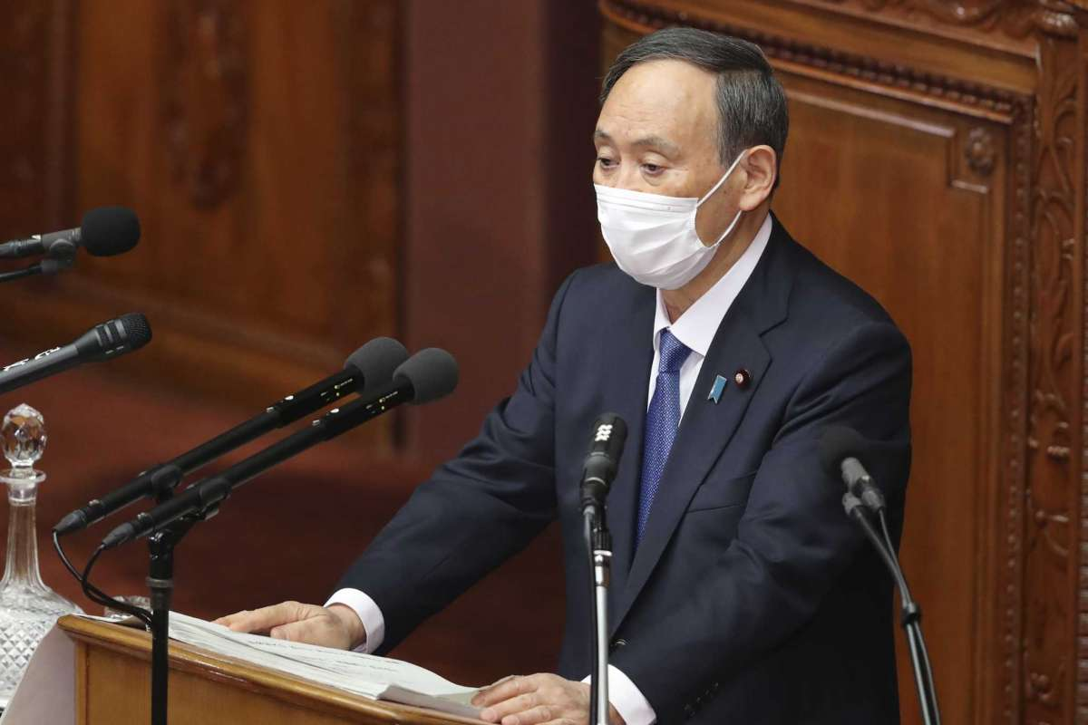 Japanese Prime Minister Yoshihide Suga delivers a policy speech during an ordinary Diet session at the upper house of parliament in Tokyo, Monday, Jan. 18, 2021.Koji Sasahara/AP